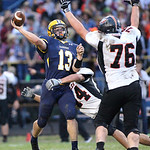 13SEP13_North Ridgeville's Jason Lucas gets off a pass under heavy pressure from North Olmsted's Jake Jones (44) and Zach Jones (76) in the 2nd quarter at North Ridgeville High School. photo …