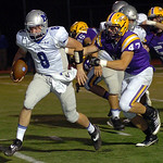 Midview quarterback Cody Callaway runs for yardage with Avon's Kevin Maloney in pursuit. LINDA MURPHY/CHRONICLE