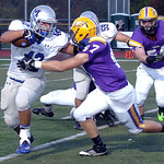 Midview's Brett Zupancic tries to get by Avon's Kevin Maloney. LINDA MURPHY/CHRONICLE