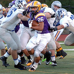 Avon's Gerett Coat tries to avoid a tackle by the Midview defensive line. LINDA MURPHY/CHRONICLE