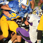 Clearview RB Dennis Cruz manages to keep the ball with one hand as Vermilion's Brenden Zannoni uses both hands to try to strip it away. photo by Ray Riedel
