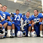 Brunswick Blue Devils take a knee in the locker room prior to the Devils taking the field against Medina for the first week of Friday night football. Photo by Aaron Josefczyk