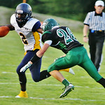 North ridgevilles DeMario McCall # 2 breaks the oncoming tackle from Westlakes # 26 Kevin McLaughlin. Photo by Amanda K. Rundle