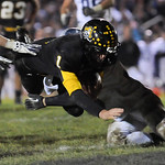 Black River's Brock Waltz dives into the end zone past Fairless's Zack Kelly and Jeremy Mahaaffey in the second quarter.  JUDD SMERGLIA/CHRONICLE