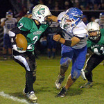 Columbia's Jesse Lambert tries to get by Chippewa's Marty Harrell Saturday night. LINDA MURPHY/CHRONICLE