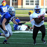 Stripes' Emaje Payton of Clearview runs before being tackled by Devon Crum of Midview. STEVE MANHEIM/CHRONICLE