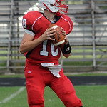 Elyria qb Hunter Parsh sets up for a throw Sep. 21.  steve Manheim