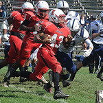 Elyria Jumarr Lewis runs for yardage Sep. 21.  Steve manheim