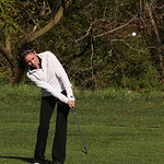 Corynn Krieg hits the ball during match play against Avon.
