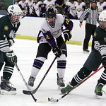 ANNA NORRIS/CHRONICLE<br /> Avon&#039;s Joe Goetz battles for control of the puck against Western Reserve Academy&#039;s Alec Rhodes, left, and Austin Rand.