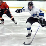 Midview's Jacob Scheetz takes the puck around the Normandy goal. LINDA MURPHY/CHRONICLE