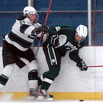 EC's #24 Jeremy Ng checks Westlakes #12 Connor Fife.