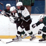 EC's #11 Collin Lester fights Westlake's #6 Colin Adams and #11 Alex Miller for the puck.