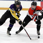 ANNA NORRIS/CHRONICLE<br /> Avon&#039;s Neal Novotny moves the puck up the ice against North Olmsted&#039;s Shane Malinak in the first period Sunday afternoon at the North Olmsted Recreation Complex.
