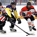 ANNA NORRIS/CHRONICLE<br /> North Olmsted&#039;s Shane Malinak and Avon&#039;s Alex Guzik fight for control of the puck in the first period Sunday afternoon at North Olmsted Recreation Complex.