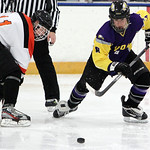 ANNA NORRIS/CHRONICLE<br /> Avon&#039;s Nick Stevens passes the puck up the ice away from North Olmsted&#039;s Shane Malinak in the second period Sunday afternoon at the North Olmsted Recreation Complex.