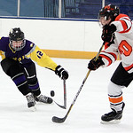ANNA NORRIS/CHRONICLE<br /> Avon&#039;s Joe Goetz goes in to block North Olmted&#039;s Nathan Schmitt&#039;s pass in the first period Sunday afternoon at the North Olmsted Recreation Complex.