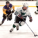 Westlake's Max Prexta takes the puck past Avon's Neal Novotny. LINDA MUPRHY/CHRONICLE