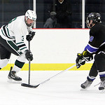 ANNA NORRIS/CHRONICLE<br /> Westlake&#039;s Paul Freedman moves the puck against Midview&#039;s Kyle Nagel in the first period Sunday night at Hamilton Ice Arena in Rocky River.