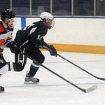 North Olmsted's Shane Malinak, left, and Westlake's Ellis Langermeier race for the puck. STEVE MANHEIM/CHRONICLE