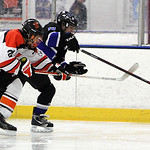ANNA NORRIS/CHRONICLE<br/>North Olmsted&#039;s Noah DeJoy and Midview&#039;s Jacobs Lyons chase down the loose puck in the first period Sunday afternoon at the North Olmsted Recreation Center.