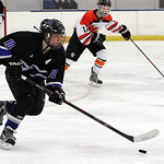 ANNA NORRIS/CHRONICLE<br /> Midview&#039;s Jacob Lyons pushes the puck up the ice against North Olmsted Sunday afternoon at the North Olmsted Recreation Center.