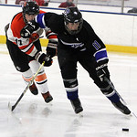 ANNA NORRIS/CHRONICLE<br /> Midview&#039;s Kyle Kudela pushes off North Olmsted&#039;s Shane Dunn as Kudela moves the puck down the ice in the first period Sunday afternoon at the North Olmsted Recreation C &#8230;