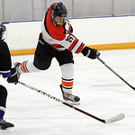 ANNA NORRIS/CHRONICLE<br/>North Olmsted defender Seth Voelker smacks the puck out of Midview territory in the second period Sunday afternoon at the North Olmsted Recreation Center.