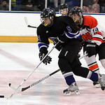 ANNA NORRIS/CHRONICLE<br/>Midview&#039;s Jacob Hack pushes the puck towards the goal against North Olmsted&#039;s Seth Voelker in the second period Sunday afternoon at the North Olmsted Recreation Center.