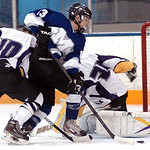 Midview's #13 Manny Ceja draws shoots the puck past Avon goalie #29 Joe Sefchik and #10 Braeden Friss for a goal.