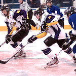 Avon's #12 Joe Goetz (middle) and #44 Alex Guzik take the puck down the ice past Midview's #5 Jacob Hack.