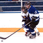 Midview's #11 Kyle Kudela takes the puck past Avon's #9 Brian Fielding.