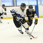 Midview's Austin Steindl (22) beats Olmsted Falls' captain Jeremy Polcar (15) to the puck.  photo by Ray Riedel