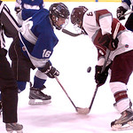 Midview's #16 K.C. Kudela faces off with Rocky River's #8 Eric Sperli for the puck.