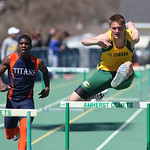 Steele Wasik, of St. Ed's wins the 300m hurdles at the 2014 Comet Relays. photo by Ray Riedel