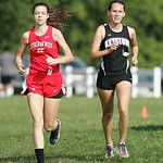 Shannon Wargo (1st place) of Keystone races alongside North Ridgeville resident Michaela Bierly (2nd place) of Lutheran West at Carlisle Reservation in the PAC Icebreaker meet. photo by Ray …