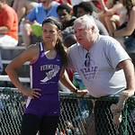 Hannah Bartlome gets guidance from Vermilion assistant Bill Andrews at the long jump finals of the OHSAA state championship. photo by Ray Riedel