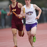 Sean Kane holds the lead against Avon Lake's Ian Korney in the final leg of Avon's first-place finish in the distance medley. RAY RIEDEL/CHRONICLE