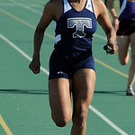 Lamia Scott of Lorain anchors the girls 4X200 meter relay. STEVE MANHEIM/CHRONICLE