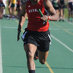 Zachary Robinson of Elyria anchors the boys 4X200 meter relay. STEVE MANHEIM/CHRONICLE