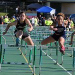Destiny Wilson of Lorain wins the girls 100 meter hurdles next to Medina's Alyssa Acevedo. STEVE MANHEIM/CHRONICLE