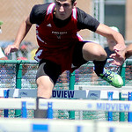 Firelands' Cole Lewis races in the boy's 100m hurdle. KRISTIN BAUER | CHRONICLE