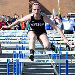 Jenna Quillen of Keystone runs in the girls 100 meter hurdles preliminary event. STEVE MANHEIM/CHRONICLE