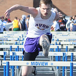Chad Allen of Avon runs in the boys 110 meter hurdles preliminaries. STEVE MANHEIM/CHRONICLE