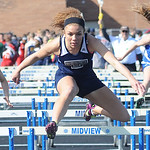 Destiny Wilson of Lorain competes in the girls 100 meter hurdles preliminary event. STEVE MANHEIM/CHRONICLE