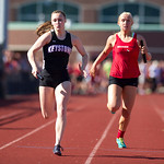 Emily Peters of Keystone Edges Tyller Holley of Brookside in the 4×100 Relay