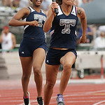 Tierra Goodman takes the baton from lamia Scott for the 3rd leg of Lorain's 4x100m relay at the OSHAA state track meet in Columbus. photo by Ray Riedel