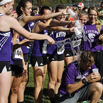 12Oct13_The Keystone girls cross country team celebrates their 1st place victory in the PAC championship by splashing water on their coach as he posed for a photo. photo by Ray Riedel