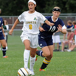 Amherst Mia Haslage moves ball away from Magnificat 10 Paige Rombach Sep 17.  Steve Manheim