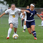 Amherst Julie Lacock moves downfield with Magnificat 7 Natalie Coury Sep 17.  steve Manheim